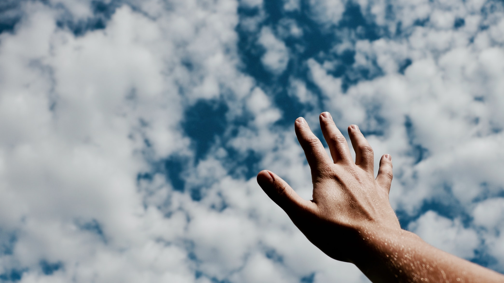 Hand touching the sky