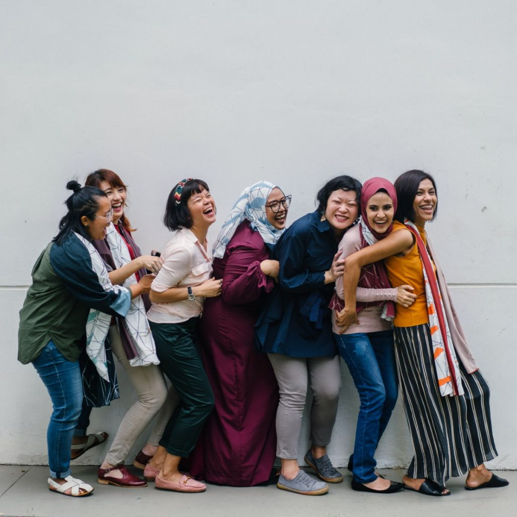 Seven women from many countries having fun together